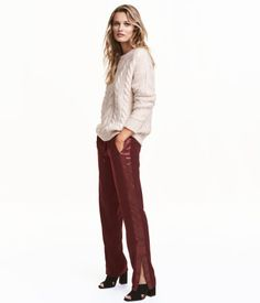 Burgundy. Joggers in lightweight woven fabric with satin stripes along outer legs. Elasticized drawstring waistband, side pockets, and concealed zip at hems