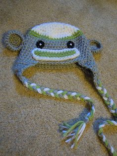 Free knitting pattern for the CUTEST sock monkey hat ever... personalize in whatever color you want!
