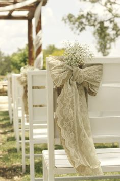 Burlap and lace bows on chairs are a great, easy, way to decorate for the ceremony.