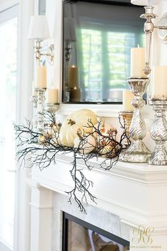 3 Days of Halloween – Glam Halloween Home Tour Fall mantel gone spooky with mercury glass candles, white pumpkins and a black swag. 3 Days of Halloween – Glam Halloween Home Tour – Randi Garrett Design Halloween Rustique, Farmhouse Halloween, Halloween Mantel, Halloween House, Happy Halloween, Halloween Window Display, Costume Halloween, Halloween Pumpkins, Fall Mantel Decorations