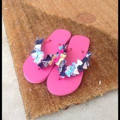 Brand new flip flops decorated w/ t-shirt material So soft & comfortable....Never worn....Size 8-9. Other sizes and colors available... Just ask 😁 My mom and I have a business where we make items from upcycled t-shirts.... check out our links at www.ohziedesigns.com none Swim