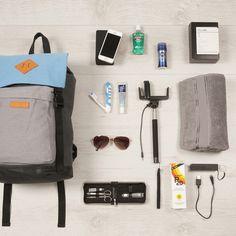 Glastonbury Festival Essentials: Colour block backpack, men's grooming kit, aviator sunglasses, travel toothbrush, suncream, portable speaker, selfie stick and phone power pack.