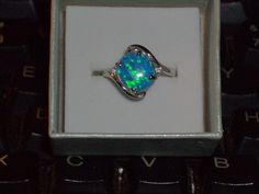 LOOK!!! A STUNNING STERLING SILVER AUSTRALIAN BLUE FIRE OPAL AND AAA CZ ENGAGEMENT RING SIZE 6