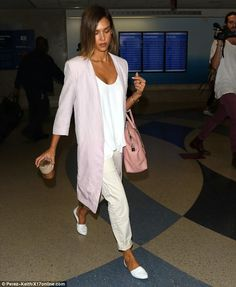 Good look: The mother-of-two looked business casual in the best way pairing her pastel clo...