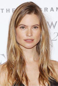 Bahati Prinsloo in barely-there makeup and perfectly tousled beach waves