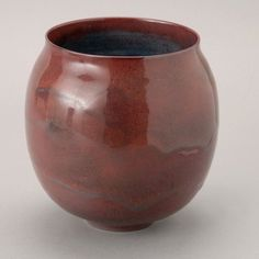 "Gertrude & Otto Natzler (Americans, 1908-1971/1908-2007) The wheel thrown ovoid form with high lustre oxblood flambe glaze, the interior with runny turquoise glaze, signed on unglazed base ""Natzler"". Art Pottery Vase. Circa 1960. Height 7 3/4 inches (19.5 cm); diameter at rim 5 3/4 inches (14.5 cm)"