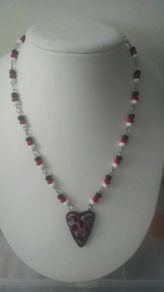 Check out this item in my Etsy shop https://www.etsy.com/listing/273045130/redblackwhite-necklacepolymer-clay