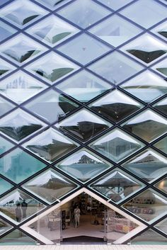Prada shop, a glass and steel shopping experience made of diamond shaped  windows, designed by Herzog   de Meuron in the fashionable Aoyama district  in Tokyo ... 4354f2e1f3