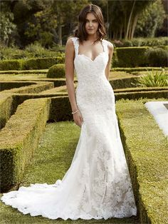 Inaru from Blue By Enzoani is a lace dress with a long train and sweetheart neckline