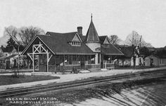 Caption: Historic postcard of the B&O station in Madisonville, built in 1888. This view is looking northwest from Tompkins Avenue, across the tracks to the ...