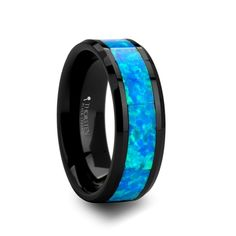 The ATWOOD Black Ceramic Ring with Blue Green Opal Inlay is on sale now, including free shipping, lifetime resizing, and lifetime warranty!