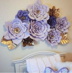$95 - Etsy - Please note: These WILL NOT be shipped until September. Handmade paper flowers. Can be used as a backdrop for any type of event or as a statement piece in the home or retail boutique. This listing is for a set of 9 giant paper flowers that have been hand cut.