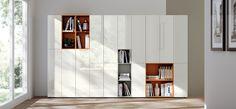 'LiberaMente' Independent Living Solution. Doors: Gloss Lacquered in Prestige White SCAV028. Open-fronted Elements: Matt Lacquered in Kumquat Orange SCAV503 & Flax SCAV377.