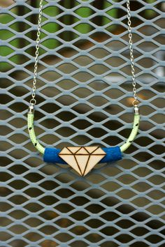 Glow in the Dark Neon Yellow Chunky Rope Statement Necklace with Blue Suede Leather and Wooden Diamond Shaped Charm by TheGlim on Etsy.