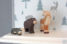 Once upon a time, in the fir trees of a Swedish forest, there lived a bear, a badger and a stag. A young explorer had come to join them, and after a day of adve