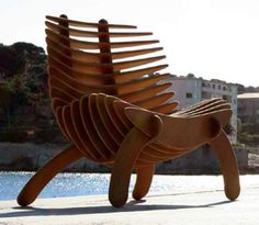 reminds me of a Viking vessel and or a fish skeleton... Anyways, I love this chair... so cool!!
