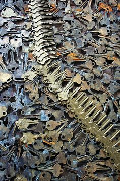 The facade of Greenwich Locksmiths in New York City is covered in swirling patterns of discarded keys, installed entirely by the owner Phil Mortillaro in October 2010.