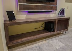 Floating tv stand, entertainment center, custom wood working