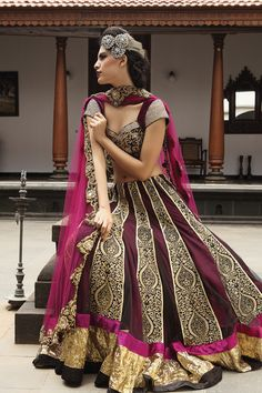 stunning deep magenta outfit with gold linings.