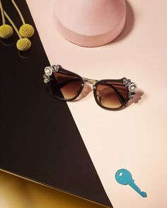 These jeweled Miu Miu sunnies are the key to a luxurious look.