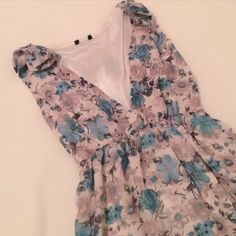 Flower Dress Flower dress with bow over shoulders. Has lace around the bottom. Item does not have tag but fits like a small.   Any Questions Please Ask before Purchase No Paypal || No Trades || Posh Rules Only Dresses