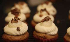 Cupcake created in tribute to President Woodrow Wilson. The cupcake brown sugar and cinnamon flavored with chopped pecans. The frosting is a basic cream cheese frosting. These are topped with a bit of buttered pecans.