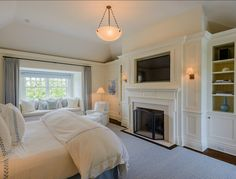 To me, the perfect design for a bedroom...window seat, bookcases, fireplace, and not too big...keeping it warm and cozy.