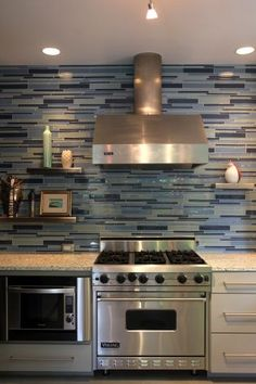 love how they took that back splash all the way up to the ceiling Green Tile Backsplash, Kitchen Backsplash, Tiles, Glass Front Cabinets, Wood Cabinets, Neutral Kitchen Colors, Woven Shades, Custom Shades, All White Kitchen