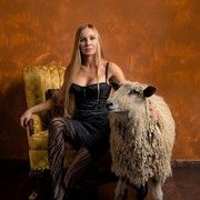 'Shear Madness' TV personality Natalie Redding models her favorite fashion looks along side Ewe, Wensleydale sheep. Natalie is wearing a vin...