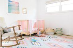 Em Scott's Vibrant Yet Minimal Nursery featuring Kalon's CARAVAN CRIB PINK