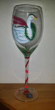 This listing features one piece of crystal stemware from the Block Basics set of 12 Days of Christmas. This glass is 7 Swans a Swimming. This hand-painted all-purpose goblet is from 2003, and made by the Block China and Crystal Company.