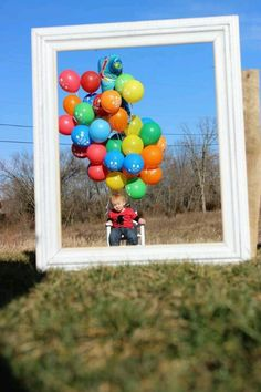 My little man's 1st birthday we saved some of the ballons and used his frame that we had his newborn to one yr pics on
