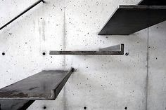 Lacquered steel steps imbedded in concrete. C.C. Sic Viresco!