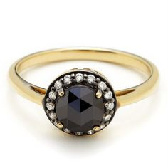 vintage inspired silhouette with tiny diamonds encircling the center stone