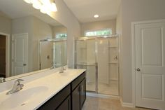 Dual vanity sinks, linen closet, and standing shower complete this Allendale master bath. http://www.hunterquinnhomes.com/Home-Plans/Allendale.aspx