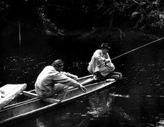 At siesta time after lunch everybody took it easy. Director Huston (right) fished doggedly with technician Kevin McClory, never caught a thing.""