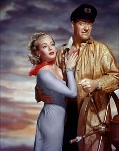 Portrait of Lana Turner and John Wayne in The Sea Chase directed by John Farrow, 1955