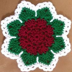 Flat Rose crochet dishcloth from bestfreecrochet.com.