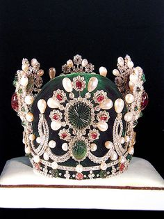 Farah Dibah tiara of the Iranian imperial family. Van Cleef and Arpels, 1967. Set with solitary rubies, emeralds, diamonds and pearls.