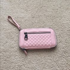 Steve Madden wallet Pink Steve Madden wallet. A pen mark as shown in picture. Kind of have some dark marks around the zip part from being in my purse as shown in picture. Steve Madden Bags Wallets
