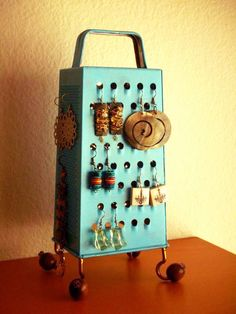 DIY Grater Accessory Holder.... Great idea but all my earrings r so long!!
