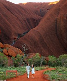 Dramatic scenes: The royal couple take in the sights as they walk down Kuniya Walk at the base of Uluru in Ayers Rock, Australia