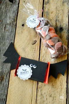 Free Halloween Printables Tags and Gift Labels   theidearoom.net cover a Kit Kat Bar (or any candy bar really) with black cardstock and then cut out and add some wings by gluing them onto the back INSIDE the wrapper.  Add some googly eyes and these Halloween Printable Tags.