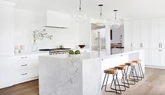 The marble island in this kitchen designed by Amber Lewis of Amber Interiors is definitely the focal point. We love its chunky frame and how the stools work with it to add a little rusticity.