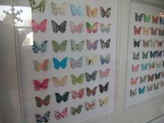 Butterflies in frame, cut with a puncher from a bunch of old magazines! Too cute and creative.