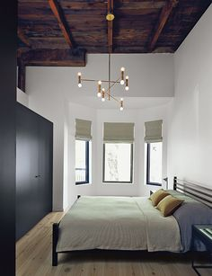 Montreal master bedroom with the original roof exposed
