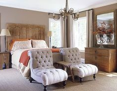 Unique idea for seating in the bedroom. Use twin tufted chairs at the foot of the bed instead of a bench.