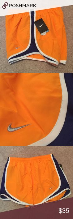 NWT size small Nike dri-fit shorts New with tags size small Nike dri-fit shorts. Shorts and orange and navy blue. Shorts have underwear-like lining on the inside Nike Shorts