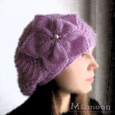 Free knitting pattern for slightly slouchy lace hat with flower For Joanna and more free slouchy hat knitting patterns at http://intheloopknitting.com/slouchy-hat-knitting-patterns/