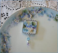 """Handpainted Bavarian Forget-me-nots or Lilacs, Broken China Jewelry Pendant Necklace Embellished with Crystals """"Lavender Blue, Dilly, Dilly"""" Jewelry Crafts, Jewelry Art, Beaded Jewelry, Handmade Jewelry, Jewelry Design, Vintage Jewelry, Jewlery, Porcelain Jewelry, Ceramic Jewelry"""